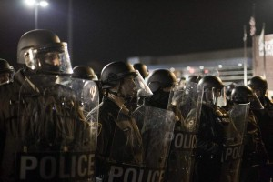Police in military gear opposing protestors in Ferguson in 2014