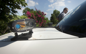 License plate scanner mounted on police car