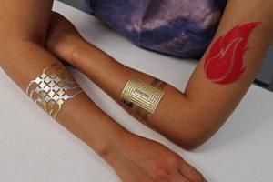 DuoSkin's metallic tattoos allow people to create three types of user interfaces on their skin